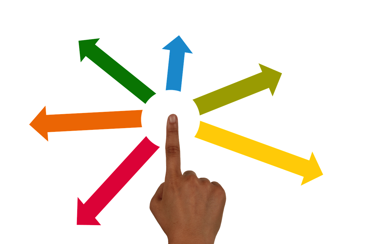 hand of POC pointing to multicolored arrows pointing in all directions